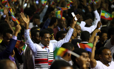 Residents cheer as they attend a concert at the Millennium Hall in Addis Ababa