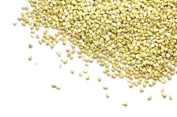 Green buckwheat groat isolated on white