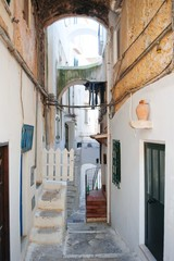 Atmospheric narrow streets in the historic center of Sperlonga in central Italy.