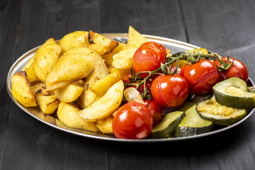 baked potatoes with tomatoes and zucchini