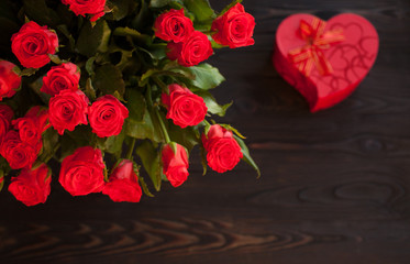 Coral roses on wooden vintage table with copy space