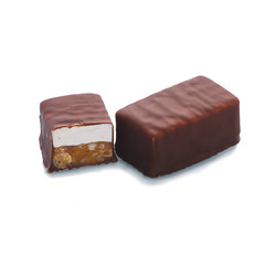 Chocolate bar in a cut on a white background isolate. Isolated chocolate dessert with caramel filling and nougat. Smooth cut of the chocolate.