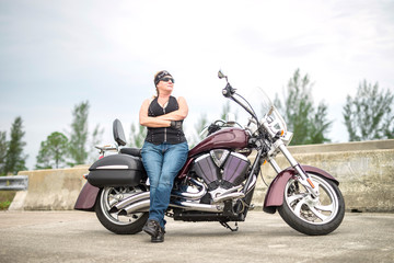 Female Biker or Woman Motorcycle Rider with Arms Crossed