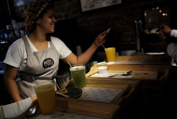 Natural orange and pineapple juices are seen during breakfast inside 'Padoca do Mani' bakery in Sao Paulo