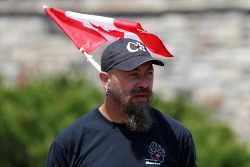 A member of the far-right group Canadian Combat Coalition attends an anti-immigration rally on Parliament Hill in Ottawa