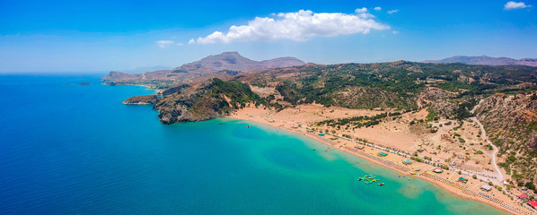Aerial birds eye view drone photo Tsambika beach near Kolympia on Rhodes island, Dodecanese, Greece. Sunny panorama with sand beach and clear blue water. Famous tourist destination in South Europe