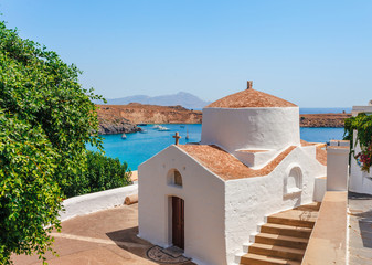 Fotobehang Cyprus Sea skyview landscape photo bay and orthodox church in Lindos on Rhodes island, Dodecanese, Greece. Panorama with nice sand beach and clear blue water. Famous tourist destination in South Europe