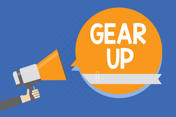 Text sign showing Gear Up. Conceptual photo Asking someone to put his clothes or suit on Getting ready fast Man holding megaphone loudspeaker orange speech bubble blue background.
