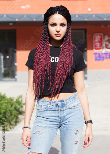 Portrait. Fashionable girl blogger with braids posing