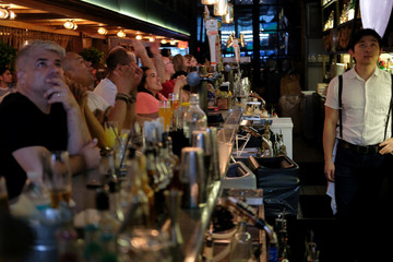 Fans at a bar in Manhattan watch as France takes the lead in the 2018 World Cup in Moscow