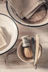 Antique barber equipment. Sharp razor, soap and brush