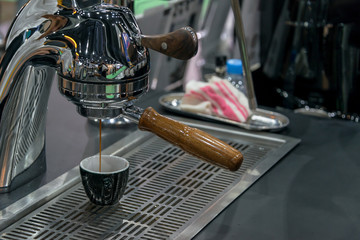 Coffee Espresso with temper in coffee machine pouring fresh a coffee