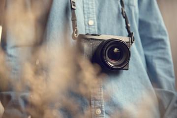 Young photographer with photos camera