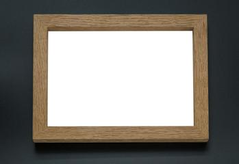 Blank wooden photo frame on black background.