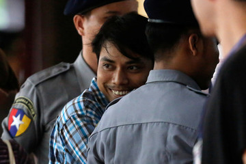 Detained Reuters journalist Kyaw Soe Oo arrives at Insein court in Yangon