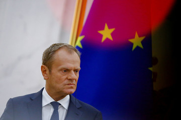 European Council President Donald Tusk attends a news conference at the Great Hall of the People in Beijing