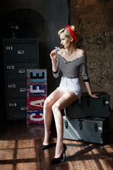 Beautiful girl dressed at pin-up style