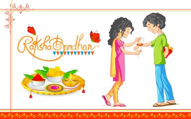 Brother and Sister tying rakhi on Raksha Bandhan, Indian festival