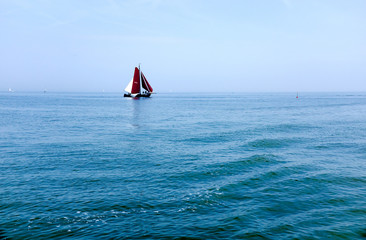 Sailing boat on blue sea  Sailing ships
