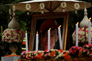 """Portrait of a former Thai navy diver, Samarn Kunan, who died during the rescue mission for the 12 boys of the """"Wild Boars"""" soccer team and their coach, near the Tham Luang cave complex, is seen in the funeral, in the northern province of Chiang Rai"""