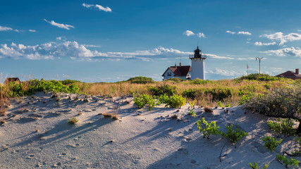 Lighthouse Point on beach dunes, Race Point Light Lighthouse in Cape Code, New England, Massachusetts, USA.