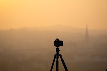 camera on the tripod village church in the early morning