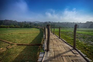 the simple wood bridge is handmade of Mae Hon Son in Thailand
