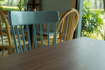 Empty table in front of blur coffee shop.