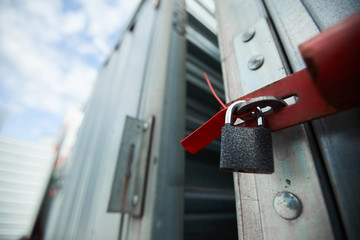 Close-up of closed cargo container on lock, sealed container in warehouse area