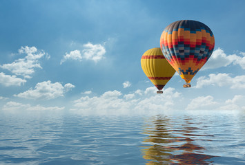 Foto op Plexiglas Ballon Colorful hot air balloon fly over the blue sea