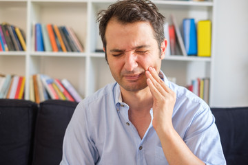 Man with gum disease feeling pain and sick