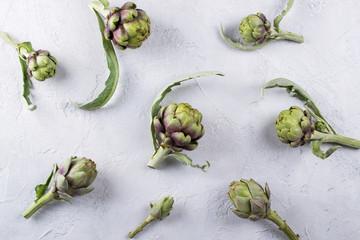 Fresh  raw artichokes on grey background. Ripe organic artichoke  pattern
