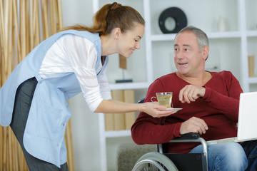 carer drink disabled man wheelchair