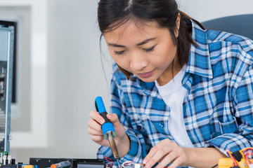 cute female engineer at home working on technology