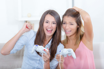 two girls are playing videogames