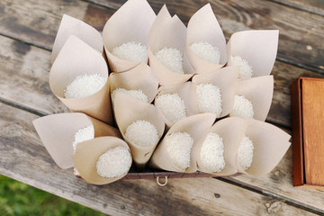 Wedding confetti with rice in paper cones. Wedding ceremony. traditional throwing of rice over married