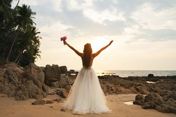 Bride wearing beautiful wedding dress on the beach