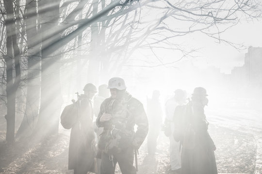 Re-enactors Dressed As German Wehrmacht Infantry Soldier In World War II