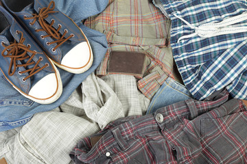 Clothes, shoes and accessories - Top view heap colorful jeans and gumshoes