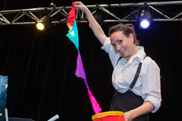 female magician performing on stage