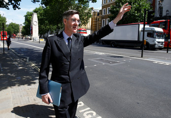 Member of Parliament, Jacob Rees-Mogg, hails a taxi in Whitehall, in central London