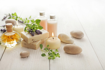 Obraz lavender SPA cosmetics: soap, essential oils, aromatherapy candles and flowers - fototapety do salonu