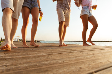 Group of friends walking outdoors on the beach.