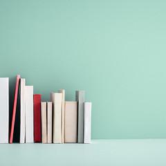 Miniature books on a shelf