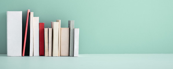 Stack of mini old books.