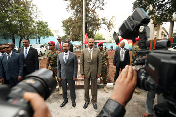 Eritrea's President Isaias Afwerki and Ethiopia's Prime Minister, Abiy Ahmed during the national anthem at the Inauguration ceremony marking the reopening of the Eritrean Embassy in Addis Ababa