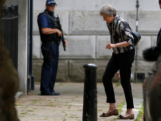 Britain's Prime Minister, Theresa May, arrives at Downing Street, in central London