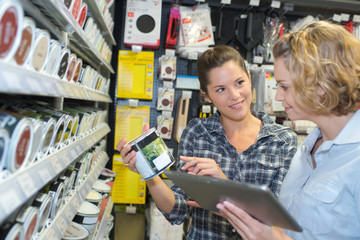 two women in deco home painting department at hardware store
