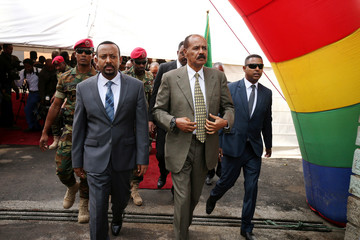 Eritrea's President Isaias Afwerki and Ethiopia's Prime Minister, Abiy Ahmed arrive for an inauguration ceremony marking the reopening of the Eritrean embassy in Addis Ababa