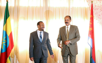 Eritrea's President, Isaias Afwerki talks to Ethiopia's Prime Minister, Abiy Ahmed during the Inauguration ceremony marking the reopening of the Eritrean Embassy in Addis Ababa